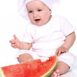 Cute baby chef with watermelon — Stock Photo