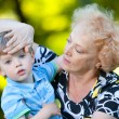 Senior woman with her grandson in the park — Stock Photo