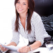 Stock Photo: Business woman doing paperwork in the office