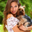 Beautiful woman with her cute dog — Stock Photo