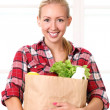 Happy smiling woman with a grocery bag — Stock Photo