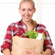 Stock Photo: Happy smiling woman with a grocery bag