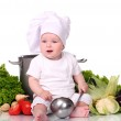 Cute baby chef with big pot and vegetables — Stock Photo #12792728