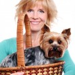 Happy mid age woman ang her yorkshire terrier — Stock Photo
