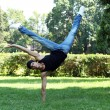 Stok fotoğraf: Handsome guy doing breakdance in park
