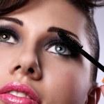 ������, ������: Beautiful woman face with mascara brush