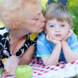 Grandmother kissing her grandson — Stock Photo