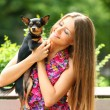 Stock Photo: Young happy woman with her cute dog