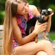 Young happy woman with her cute dog — Stock Photo