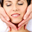 Young woman getting face massage — Stock Photo