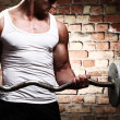 Muscular guy doing exercises with barbell — ストック写真