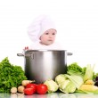Cute baby chef with big pot and vegetables — Stock Photo #12794293