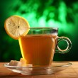 Royalty-Free Stock Photo: Cup of hot green tea with sugar and lemon