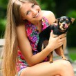 Young and happy girl with her cute dog — Stock Photo
