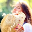 Young and beautiful woman in straw hat — Stok fotoğraf