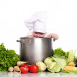 Cute baby chef with big pot and vegetables — Stock Photo #12796645