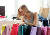Woman looking into shopping bags — Stock Photo