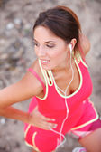 Beautiful fitness girl with headphones — Stock Photo
