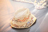 Straw hat laying on the seaside — Stock Photo