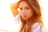 Portrait of beautiful woman in sunset light — Stock Photo