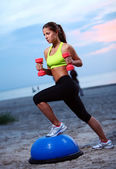 Woman doing fitness exercises with bosu ball — Stock Photo