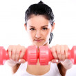 Cute and serious fitness girl with dumbbells — Stock Photo #13976015
