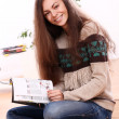 Cute young woman reading magazine at home — Stock Photo #14674279