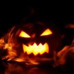 Halloween pumpkin in fire — Stock Photo #14674289