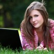 Royalty-Free Stock Photo: Beautiful woman with laptop in park