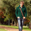 Smart guy walking at cold autumn day — Stock Photo