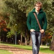 Stock Photo: Smart guy walking at cold autumn day