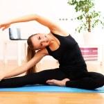 Beautiful woman do yoga exercises at home — Stock Photo #14674447