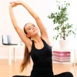 Beautiful woman do yoga exercises at home — Stok fotoğraf