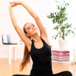 Stock Photo: Beautiful womdo yogexercises at home