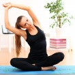 Beautiful woman do yoga exercises at home — 图库照片