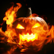 Halloween pumpkin in fire - Stok fotoraf