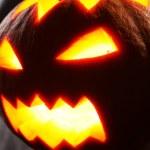 Illuminated halloween pumpkin — Stock Photo