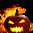 Halloween pumpkin in fire - 