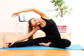 Beautiful woman do yoga exercises at home — Stock Photo