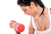 Cute and young girl do exercises with dumbbells — Stock Photo