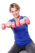 Cute mid aged women do exercises with dumbbells — Stock Photo