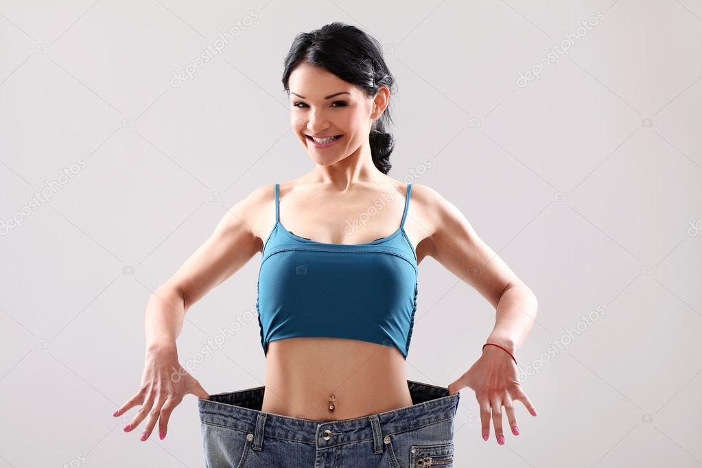Funny Woman Shows Her Weight Loss Stock Photo 9864838