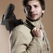 Beautiful man with boots on his shoulder — Stock Photo