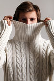Man in sweater hiding his face from cold — Stock Photo