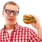 Funny man in glasses eating hamburger — Stock Photo