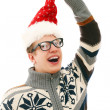 Funny man with glasses in christmas hat — Stock Photo