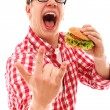 Funny man in glasses eating hamburger — Stock Photo #16687703