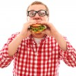 Funny man in glasses eating hamburger — Stockfoto