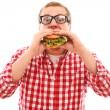 komik adam gözlüklü hamburger yemek — Stok fotoğraf
