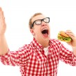 Funny man in glasses eating hamburger — Stock Photo #16688599